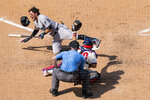 Miami Marlins' Miguel Rojas, left, reacts to getting hit by a pitch during the seventh inning of a baseball game, Sunday, July 26, 2020, in Philadelphia.  (AP Photo/Chris Szagola)
