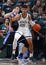 Michigan State's Malik Hall (25) maneuvers against Duke's Matthew Hurt during the first half of an NCAA college basketball game, Tuesday, Dec. 3, 2019, in East Lansing, Mich. (AP Photo/Al Goldis)