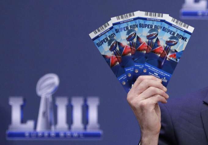 Michael, Buchwald, NFL Senior Counsel, Legal, holds up Super Bowl 53 tickets as he explains the security features on the tickets during a news conference for the NFL Super Bowl 53 football game Thursday, Jan. 31, 2019, in Atlanta. (AP Photo/David J. Phillip)