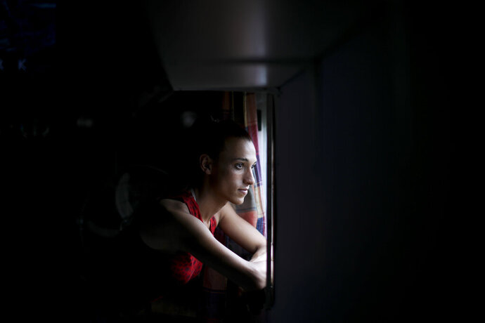 Soccer player Mara Gomez poses for a portrait at her home in La Plata, Argentina, Thursday, Feb. 6, 2020. Gomez is a transgender woman who is limited to only training with her women's professional soccer team, Villa San Carlos. She is waiting for confirmation from the Argentina Football Association (AFA) she can play. (AP Photo/Natacha Pisarenko)