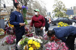 "Flower sellers arrange their flowers ahead of the Persian New Year, or Nowruz, meaning ""New Day."" in northern Tajrish Square, Tehran, Iran, Monday, March 15, 2021. (AP Photo/Vahid Salemi)"