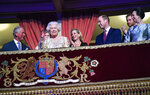 Britain's Queen Elizabeth II, surrounded by members of the royal family, takes her seat at the Royal Albert Hall in London on Saturday April 21, 2018, for a concert to celebrate the  92nd birthday of Queen Elizabeth II. (Andrew Parsons/Pool via AP)