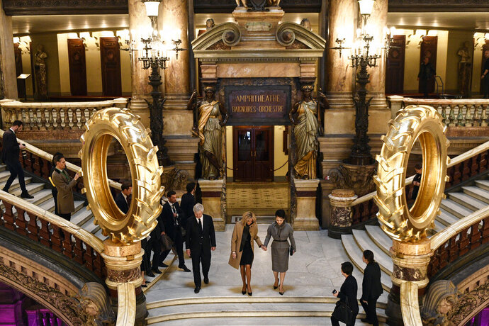 French president's wife Brigitte Macron, center left, and Chinese president's wife Peng Liyuan visit the Palais Garnier opera house in Paris as part of a state visit to France, Monday, March 25, 2019. The Chinese President is on a three-day state visit to France. (Martin Bureau/Pool Photo via AP)