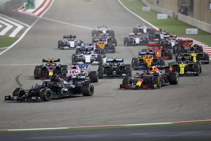 Mercedes driver Lewis Hamilton of Britain leads at the start of the Formula One Bahrain Grand Prix in Sakhir, Bahrain, Sunday, Nov. 29, 2020. (Tolga Bozoglu, Pool via AP)