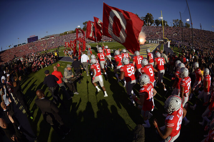 Ohio State takes the field before the Rose Bowl NCAA college football game against Washington Tuesday, Jan. 1, 2019, in Pasadena, Calif. (AP Photo/Mark J. Terrill)