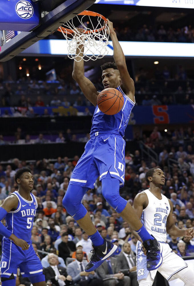 Duke's Javin DeLaurier (12) dunks against North Carolina during the first half of an NCAA college basketball game in the Atlantic Coast Conference tournament in Charlotte, N.C., Friday, March 15, 2019. (AP Photo/Chuck Burton)