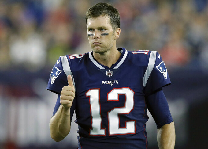 "FILE - In this Aug. 16, 2018, file photo, New England Patriots quarterback Tom Brady signals a thumbs-up on the sideline during the second half of a preseason NFL football game against the Philadelphia Eagles in Foxborough, Mass. Six-time Super Bowl champion Tom Brady has signed a two-year contract with the Tampa Bay Buccaneers, saying he is embarking on a ""new football journey."" The 42-year-old quarterback who spent the first 20 years of his career with the New England Patriots announced his decision Friday, March 20, 2020, in an Instagram post and thanked the Bucs for the opportunity.(AP Photo/Charles Krupa, File)"