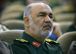 In this April 24, 2019, Iran's Revolutionary Guard commander Gen. Hossein Salami attends a meeting in Tehran, Iran. Iran's Revolutionary Guard shot down a U.S. drone on Thursday, June 20, 2019, amid heightened tensions between Tehran and Washington over its collapsing nuclear deal with world powers, American and Iranian officials said, while disputing the circumstances of the incident. Salami, speaking to a crowd in the western city of Sanandaj on Thursday, described the American drone as