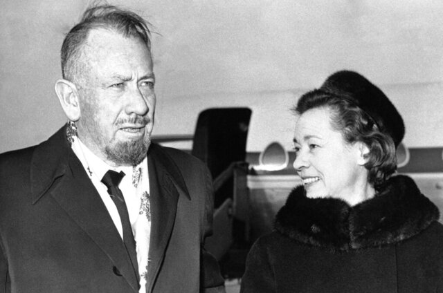 FILE - In this Dec. 13, 1962, file photo, author John Steinbeck, with his wife Elaine arrive at London Airport. Curated Estates in Lincoln Park, N.J. is offering Steinbeck items for auction, including dozens of letters that Elaine wrote from their world travels.  The items will be sold on Feb. 27. (AP Photo/File)