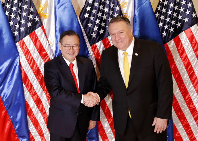 Philippine Foreign Affairs Secretary Teodoro Locsin Jr., left, and U.S. Secretary of State Mike Pompeo shake hands prior to their bilateral meeting in suburban Pasay city, southeast of Manila, Philippines Friday, March 1, 2019. Pompeo is in the Philippines for talks on the two countries' relations as well as the mutual defense treaty. (AP Photo/Bullit Marquez)