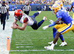 Syracuse quarterback Eric Dungey, left, dives over the goal line Pittsburgh defensive back Jazzee Stocker (7) for a touchdown in the second half of an NCAA football game, Saturday, Oct. 6, 2018, in Pittsburgh. Pittsburgh won 44-37 in overtime. (AP Photo/Keith Srakocic)