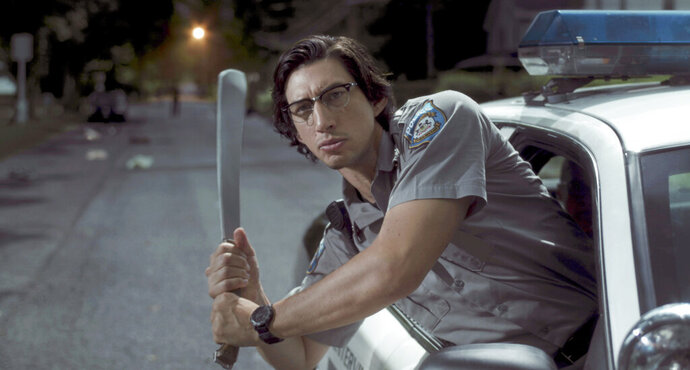 In this image released by Focus Features shows Adam Driver as