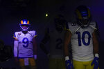 Los Angeles Rams quarterback Matthew Stafford (9) waits alongside wide receiver Cooper Kupp (10) before an NFL football game against the Chicago Bears, Sunday, Sept. 12, 2021, in Inglewood, Calif. (AP Photo/Marcio Jose Sanchez)