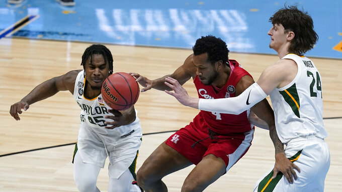 Houston forward Justin Gorham (4) loses the ball between Baylor guard Davion Mitchell (45) and guard Matthew Mayer (24) during the first half of a men's Final Four NCAA college basketball tournament semifinal game, Saturday, April 3, 2021, at Lucas Oil Stadium in Indianapolis. (AP Photo/Darron Cummings)