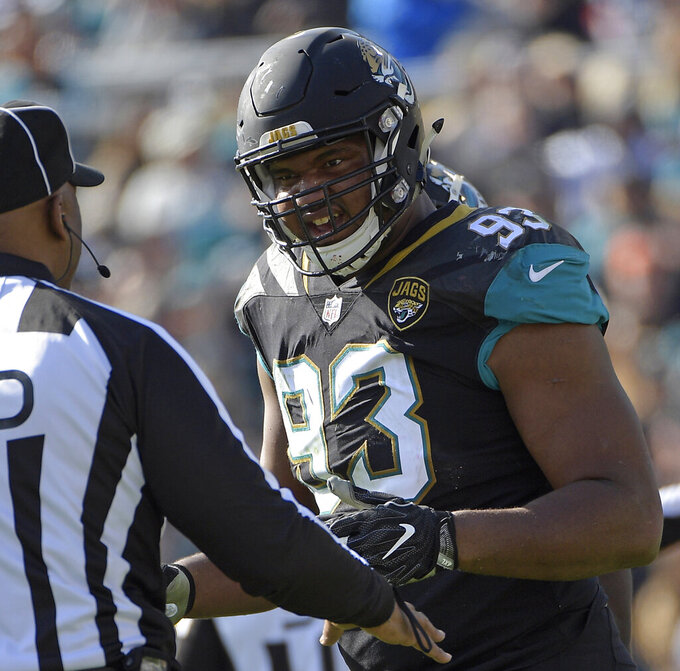 FILE - In this Jan. 7, 2018, file photo, Jacksonville Jaguars defensive end Calais Campbell (93) has a discussion with an official in the first half of an NFL wild-card playoff football game against the Buffalo Bills, in Jacksonville, Fla. Campbell watched the NFL's conference championship games on his phone while flying home from South Africa last weekend. Campbell was stunned officials chose not to penalize Robey-Coleman for flattening Saints receiver Tommylee Lewis before the ball arrived.(AP Photo/Phelan M. Ebenhack, File)