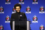 This photo provided by the NFL shows singer The Weekend speaking at the halftime press conference ahead of the Super Bowl 55 football game, Thursday, Feb. 4, 2021, in Tampa, Fla. (Perry Knotts/NFL via AP)