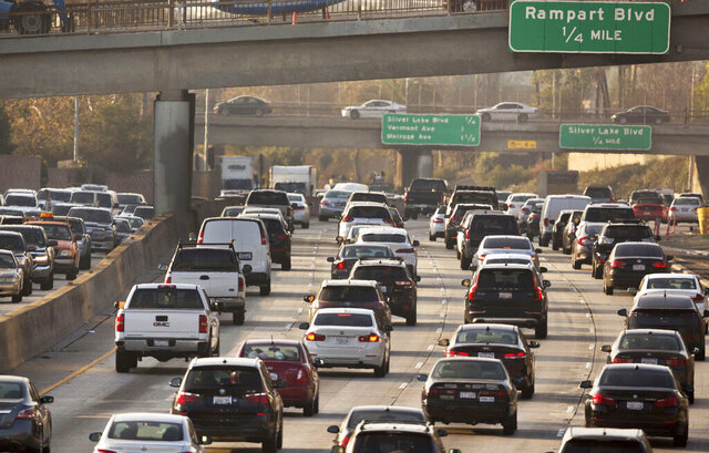 FILE - This Dec. 12, 2018, file photo shows traffic on the Hollywood Freeway in Los Angeles. The Trump administration is rolling back tough Obama-era mileage standards and gutting one of the United States' biggest efforts to slow climate change. The administration released its relaxed mileage rules Tuesday. (AP Photo/Damian Dovarganes, File)