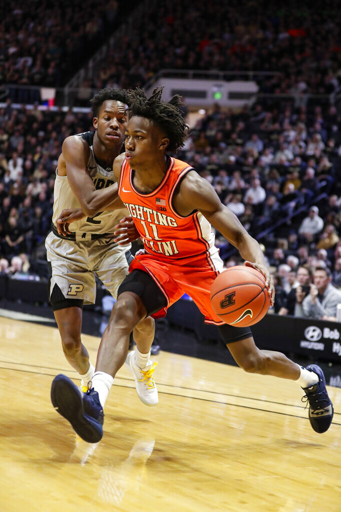 Illinois guard Ayo Dosunmu (11) drives on Purdue guard Eric Hunter Jr. (2) during the first half of an NCAA college basketball game in West Lafayette, Ind., Tuesday, Jan. 21, 2020. (AP Photo/Michael Conroy)