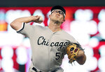Chicago White Sox pitcher Carson Fulmer throws against the Minnesota Twins in the third inning of a baseball game Wednesday, Sept. 18, 2019, in Minneapolis. (AP Photo/Jim Mone)