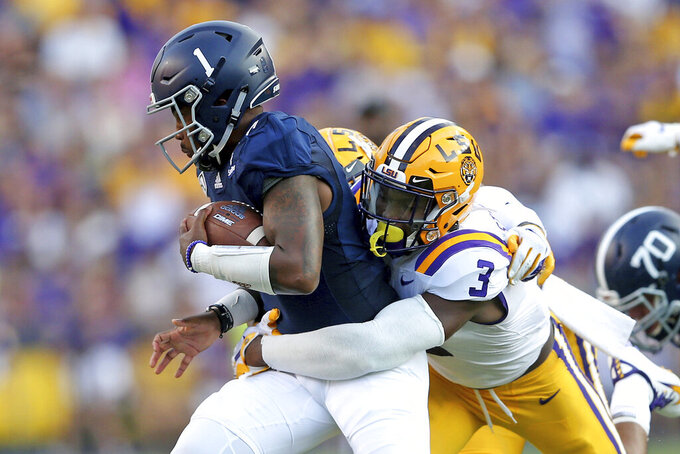 LSU safety JaCoby Stevens (3) tackles Georgia Southern quarterback Shai Werts (1) for a loss in the first quarter of  an NCAA college football game in Baton Rouge, La., Saturday, Aug. 31, 2019. (AP Photo/Michael Democker)