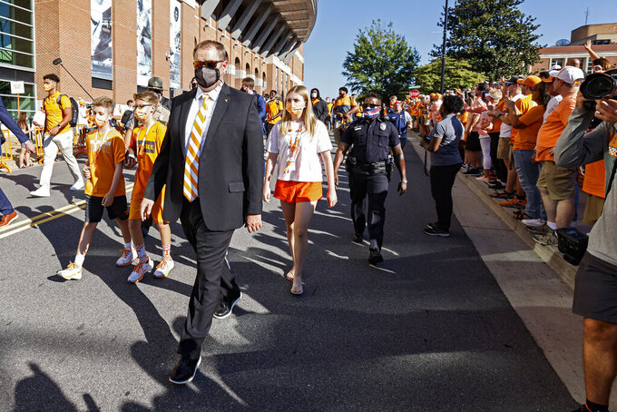Tennessee head coach Josh Heupel walks past fans during the Vol Walk before an NCAA college football game against Bowling Green, Thursday, Sept. 2, 2021, in Knoxville, Tenn. (AP Photo/Wade Payne)