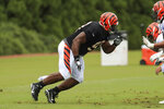 Cincinnati Bengals' Geno Atkins (97) runs a drill during an NFL football camp practice in Cincinnati, Tuesday, Aug. 18, 2020. (AP Photo/Aaron Doster)