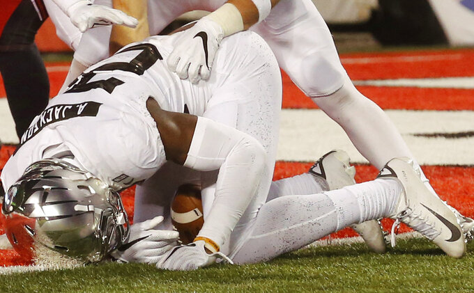 Oregon linebacker Adrian Jackson (29) falls upon a blocked punt against Utah in the second half during an NCAA college football game Saturday Nov. 10, 2018, in Salt Lake City. (AP Photo/Rick Bowmer)