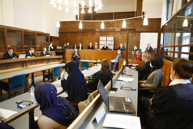 A general view shows the courtroom at the beginning of the trial of defendant Vadim K. in Berlin, Germany, Wednesday, Oct. 7, 2020. The 55-year-old man accused of gunning down a former Chechen commander, a Georgian national, in Kleiner Tiergarten Park, on August 23, 2019 has so far stayed mum over the case. (Odd Andersen/Pool Photo via AP)