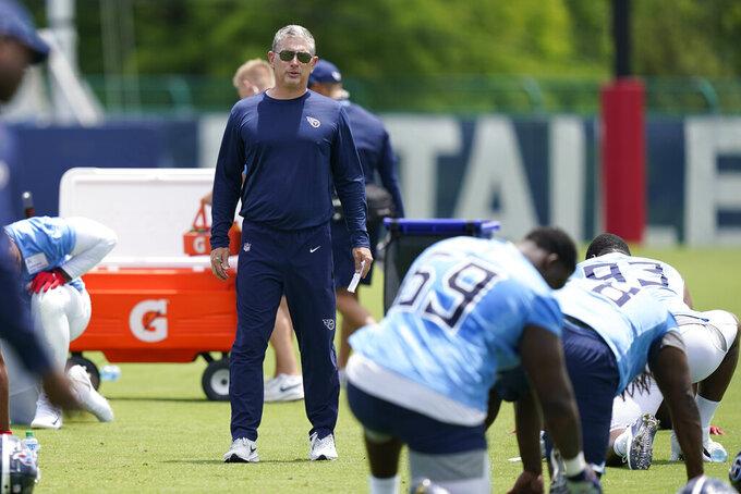 Tennessee Titans senior defensive assistant coach Jim Schwartz watches during NFL football practice Thursday, June 3, 2021, in Nashville, Tenn. (AP Photo/Mark Humphrey, Pool)