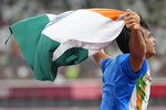 Neeraj Chopra, of India, celebrates after winning the men's javelin throw at the 2020 Summer Olympics, Saturday, Aug. 7, 2021, in Tokyo. (AP Photo/Martin Meissner)