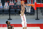 Houston guard Quentin Grimes, right, dunks as Central Florida guard Dre Fuller Jr., left, looks on during the first half of an NCAA college basketball game Sunday, Jan. 17, 2021, in Houston. (AP Photo/Michael Wyke)