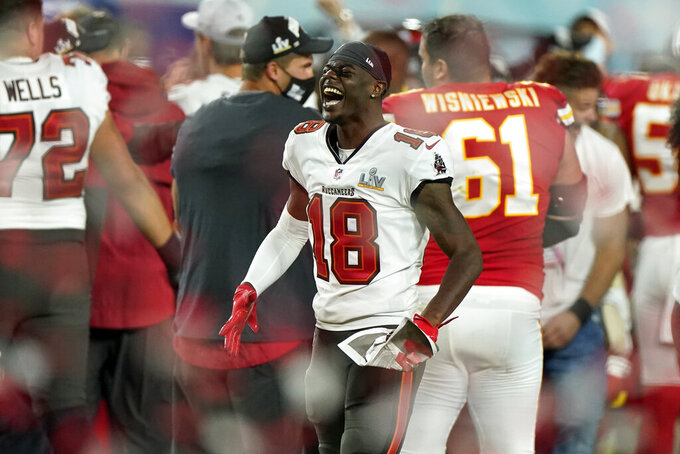 Tampa Bay Buccaneers wide receiver Tyler Johnson (18) celebrates at the end of their NFL Super Bowl 55 football game against the Kansas City Chiefs, Sunday, Feb. 7, 2021, in Tampa, Fla. The Buccaneers defeated the Chiefs 31-9 to win the Super Bowl. (AP Photo/Gregory Bull)
