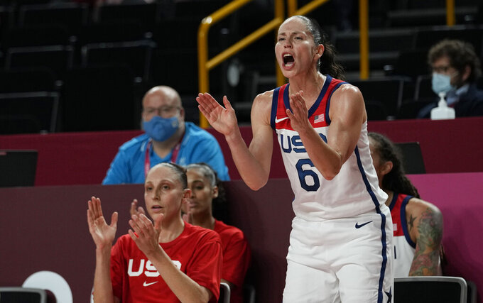 United States' Sue Bird (6) cheers for her teammates from the bench during women's basketball semifinal game between the United States and Serbia at the 2020 Summer Olympics, Friday, Aug. 6, 2021, in Saitama, Japan. (AP Photo/Eric Gay)