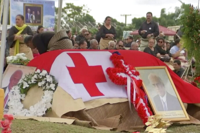 In this image from a video, a funeral service is held for the late Tongan Prime Minister 'Akilisi Pohiva in Nuku'alofa, Tonga Thursday, Sept. 19, 2019. Hundreds of mourners packed a church service on Thursday and children stood vigil on downtown streets as Tonga took a national holiday to bid farewell to Pohiva at a state funeral. (TVNZ via AP)