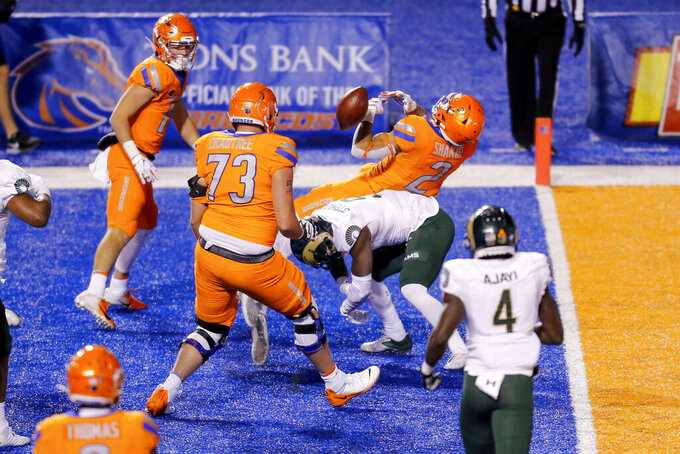 Boise State wide receiver Khalil Shakir (2) loses the ball after taking a hit from Colorado State defensive back Logan Stewart (9) near the goal line during the second half in an NCAA college football game Thursday, Nov. 12, 2020, in Boise, Idaho. Boise State won 52-21. (AP Photo/Steve Conner)