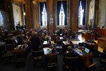 Lawmakers convene in the Senate Chambers during opening day of the Louisiana legislative session in Baton Rouge, La., Monday, April 12, 2021. (AP Photo/Gerald Herbert)