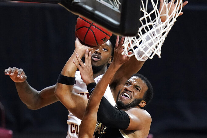 Wake Forest guard Ian DuBose, right, drives to the basket against Boston College forward CJ Felder during the first half of an NCAA basketball game Wednesday, Feb. 10, 2021, in Boston. (AP Photo/Charles Krupa)