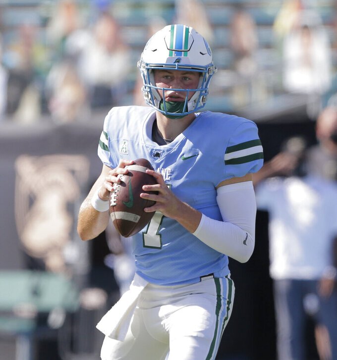 Tulane quarterback Michael Pratt (7)looks to throw against the Army during an NCAA college football game in New Orleans, La., Saturday, Nov. 14, 2020. (A. J. Sisco/The Advocate via AP)