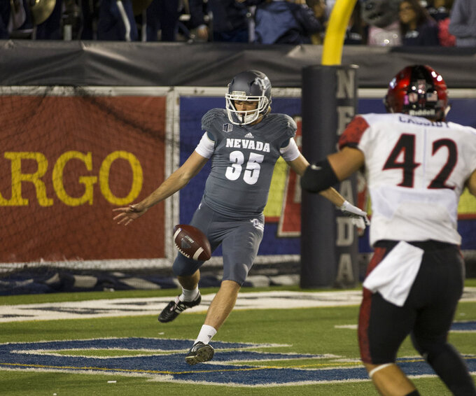Nevada kicker Quinton Conaway (35) punts out of his own end zone against San Diego State in the first half of an NCAA college football game in Reno, Nev., Saturday, Oct. 27, 2018. (AP Photo/Tom R. Smedes)