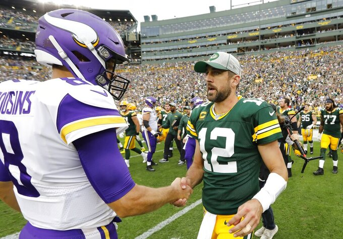 Green Bay Packers' Aaron Rodgers talks to Minnesota Vikings' Kirk Cousins after an NFL football game Sunday, Sept. 15, 2019, in Green Bay, Wis. The Packers won 21-16. (AP Photo/Mike Roemer)
