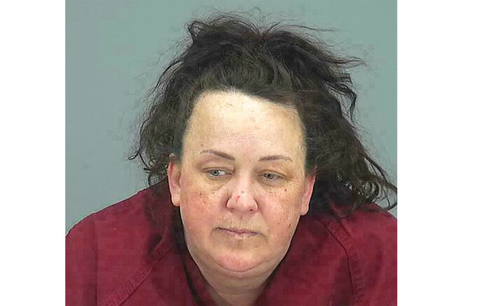 FILE - This file booking photo provided by Pinal County Sheriff's Office shows Machelle Hobson. Hobson, accused of abusing her adopted children who starred on her popular YouTube channel has died, authorities said Wednesday, Nov. 13, 2019.   Maricopa Police Department spokesman Ricardo Alvarado said Wednesday that Hobson died Tuesday at a Phoenix-area hospital. Alvarado had no information on the circumstances of Hobson's death. (Pinal County Sheriff's Office via AP, File)