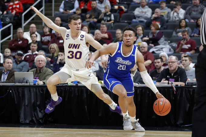 Drake's Jonah Jackson (20) dribbles as Northern Iowa's Spencer Haldeman (30) defends during the first half of an NCAA college basketball game in the quarterfinal round of the Missouri Valley Conference men's tournament Friday, March 6, 2020, in St. Louis. (AP Photo/Jeff Roberson)