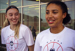 UConn basketball players Paige Bueckers, left, and Azzi Fudd, right, speak to the media outside the the school's Werth basketball practice facility in Storrs, Conn., Tuesday, July 6, 2021. Bueckers, last season's national player of the year, helped recruit her friend Fudd, the nation's top high school prospect.. (AP Photo/Pat Eaton-Robb)