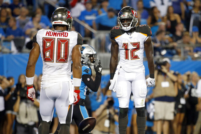 Tampa Bay Buccaneers tight end O.J. Howard (80) and wide receiver Chris Godwin (12) celebrate Godwin's touchdown against the Carolina Panthers during the first half of an NFL football game in Charlotte, N.C., Thursday, Sept. 12, 2019. (AP Photo/Brian Blanco)