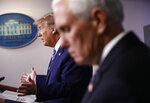 FILE - In this April 19, 2020, file photo Vice President Mike Pence, right, listens as President Donald Trump speaks during a coronavirus task force briefing at the White House in Washington. (AP Photo/Patrick Semansky, File)