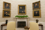 The Oval Office of the White House is newly redecorated for the first day of President Joe Biden's administration, Wednesday, Jan. 20, 2021, in Washington, including a pairing of former President Franklin D. Roosevelt over the mantle of the fireplace. (AP Photo/Alex Brandon)