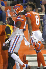 Florida wide receivers Justin Shorter (89) and wide receiver Trevon Grimes (8) celebrate after Shorter caught a pass in the end zone for a 21-yard touchdown during the first half of the team's NCAA college football game against Arkansas, Saturday, Nov. 14, 2020, in Gainesville, Fla. (AP Photo/Phelan M. Ebenhack)