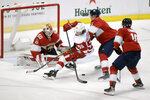 Detroit Red Wings' Tyler Bertuzzi (59) moves the puck as Florida Panthers goalkeeper Chris Driedger (60), Josh Brown, third from left, and Brett Connolly (10) defend during the second period of an NHL hockey game, Saturday, Dec. 28, 2019, in Sunrise, Fla. (AP Photo/Luis M. Alvarez)