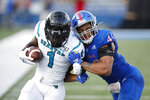 FILE - Coastal Carolina running back CJ Marable (1) attempts to get past Kansas linebacker Dru Prox (40) during an NCAA football game on Saturday, Sept. 7, 2019 in Lawrence, Kan. Coastal Carolina will visit the Jayhawks on Saturday night, Sept. 12, 2020, in the season opener for both teams. It's the lone non-conference game for Kansas, which will have a week off before visiting Baylor to open its nine-game Big 12 slate — on the date that Coastal Carolina was originally supposed to face the Jayhawks at home.(AP Photo/Colin E. Braley, File)