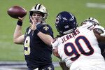 New Orleans Saints quarterback Drew Brees (9) passes under pressure from Chicago Bears defensive tackle John Jenkins (90) in the second half of an NFL wild-card playoff football game in New Orleans, Sunday, Jan. 10, 2021. (AP Photo/Butch Dill)